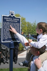 Dr. John Kreider's son and grandson with a historical marker recognizing Dr. Kreider and Dr. Mary K. Howett's work which lead to the development of the HPV vaccination. Photo courtesy of PennStateNews.